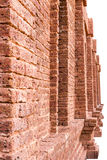 Large brick wall beside the door. Large side doors, brick walls, stacked layers of building a new model for a vintage backdrop Royalty Free Stock Image