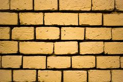 Large brickwork, yellow brick wall, sand color royalty free stock images