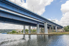 Large bridge over river in city Stock Photos