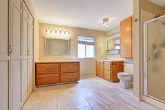 Large bright bathroom in beige color with tile floor Stock Photo