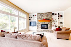 Large bright living room with fireplace Stock Images