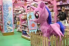 Big bright soft toys in children`s shop royalty free stock photo