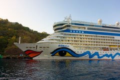 A large, brightly painted cruise ship calling at kingstown, st. vincent Stock Image