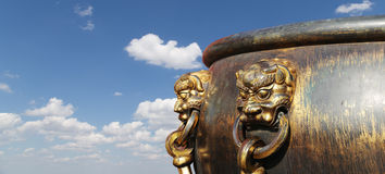 Large bronze bowl to extinguish fire with image Chinese dragon Royalty Free Stock Photo