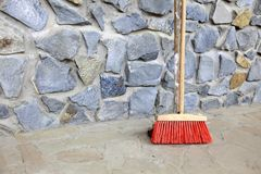 Large broom on wall outdoor - housework Stock Photography