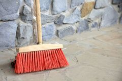 Large broom on wall outdoor - housework Stock Photos