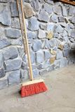 Large broom on wall outdoor - housework Royalty Free Stock Photo