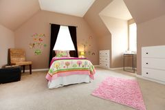 Large brown baby girl bedroom with pink. Stock Images