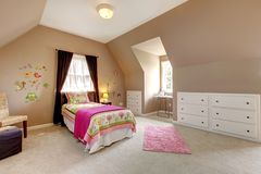 Large brown baby girl bedroom with pink bed. Stock Photo