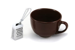 Large Brown Cappuchino Mug with Whisk and Grater. Large brown cappuchino coffee mug with chocolate grater and mini whisk stock image