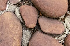 Large brown cobblestone garden decor close-up stone background base design grunge style hard natural stock image