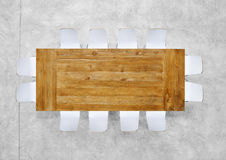 Large Brown Meeting Table with Twelve Chairs Royalty Free Stock Images