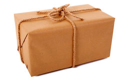 Large brown paper parcel or package tied with thick rope isolated on white Royalty Free Stock Photo