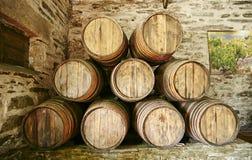 Large barrels of Porto wine stacked against the wall. Large brown wooden barrels of Porto wine stacked against the stone wall with picture Stock Photo