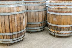 Large brown wooden barrels or wine vats stock photo