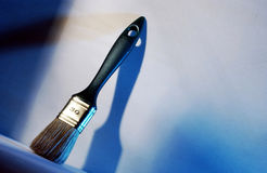 Large brush. Whit blue wood background stock photography