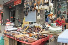Large brushes for calligraphy, Market in China. Xi`an City stock images