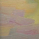 Large brushstrokes of violet and orange oil paint on canvas. Abstract background. Stock Photos