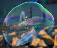 Large Bubble floating. A large bubble at the Oceanside Pier Stock Photo