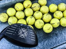 Practice Golf Balls. Large bucket of practice range golf balls waiting to be hit royalty free stock photos