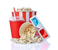 Large bucket and small cup of appetizing salty popcorn with 3d anaglyph glasses and beverage. Isolated on a white background stock images