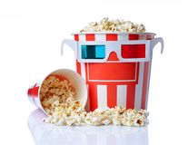 Large bucket and small cup of appetizing salty popcorn with 3d anaglyph glasses. Isolated on a white background stock photos