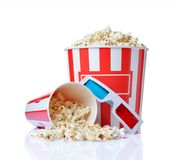 Large bucket and small cup of appetizing salty popcorn with 3d anaglyph glasses. Isolated on a white background royalty free stock image
