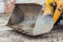 Large bucket of yellow tractor forklift, close-up, ladle stock image