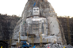 Large Buddha carved on cliff in Thailand. Stock Photos