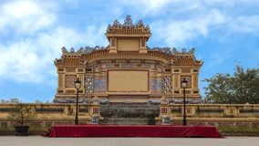 Large Buddhist outdoor venue seen from a busy street in Hue, Vietnam. Pictured is large outdoor Buddhist venue for celebration of Tet 2019. The structure has on stock image