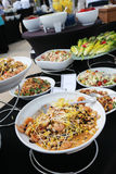 Large buffet. Various bowls of food on tables in room Royalty Free Stock Images
