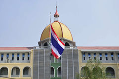 Large building with domed roof and Thai flag Royalty Free Stock Photography