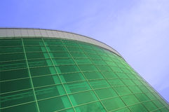 Large building of green glass. Rising in the clear blue sky Stock Photography