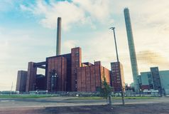 Large building and industrial plant chimneys. Large building and high industrial plant chimneys Royalty Free Stock Photos