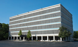 Large Building with Rows of Narrow Windows Royalty Free Stock Photos
