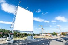 Large building site in front of building site. Under blue sky royalty free stock image