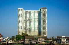 Large building and slum Stock Image