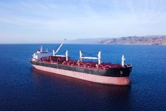 Large Bulk carrier at sea - Aerial image Stock Photos