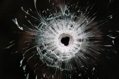 Large Bullet hole in glass. From an automatic rifle. Taken after the terrorist attacks in France the 13th November royalty free stock photos