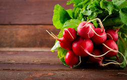 Large bunch of fresh Organic vegetables, radish on old wooden table. Closeup Stock Photography