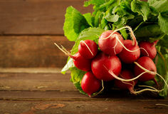 Large bunch of fresh Organic vegetables, radish on old wooden table. Closeup Royalty Free Stock Photography