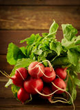 Large bunch of fresh Organic vegetables, radish on old wooden table. Toned Royalty Free Stock Images