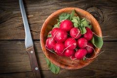 Large bunch of fresh radish. Large bunch of fresh radish on wooden boards, closeup Royalty Free Stock Photo