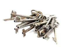 Large bunch  of old keys. On a white background Stock Image