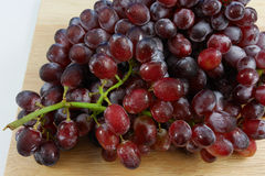 The large bunch of ripe red grapes Stock Photography