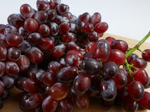 The large bunch of ripe red grapes Royalty Free Stock Photography