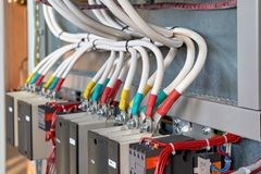 A large bundle of electrical cables or wires connected to contactors. High-power magnetic starters. Connection using a bolted connection. Large electrical royalty free stock image