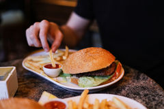 Large burger in a restaurant Stock Photos