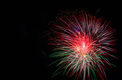 Large burst of fireworks. Fireworks on the right hand side with empty copy space on the left Royalty Free Stock Photo