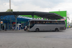 Large bus at a bus station Stock Photo